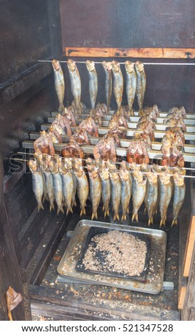 Kippers or Herrings Being Smoked in a Kiln in the Picturesque Fishing Village of Clovelly on the North Coast of Devon, England, UK