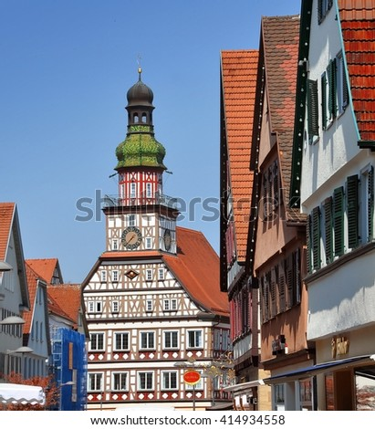 KIRCHHEIM UNTER TECK, GERMANY - APRIL 20, 2016: Street of the old town with half-timbered town hall in perspective. Kirchheim unter Teck, Baden-Wurttemberg, Germany