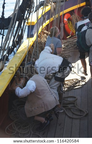 KIRKLAND, WASHINGTON - SEP 1 - The crew sets the sails of the Lady Washington     during a mock sea battle as part of Labor Day festivities on Sep 1, 2012 near Kirkland , Washington.