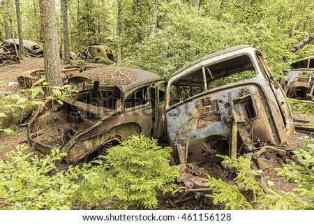 KIRKOE MOSSE, SWEDEN - 28 JULY 2016: A car graveyard situated in a forest at Kirkoe Mosse, Sweden.