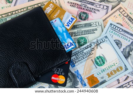 KIROV, RUSSIA - JANUARY 18, 2015: Photo of VISA and Mastercard credit card in leather wallet with USA dollars bills - stock photo
