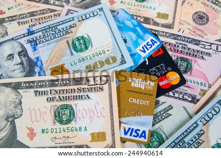 KIROV, RUSSIA - JANUARY 18, 2015: Photo of VISA and Mastercard credit card with USA dollars bills - stock photo