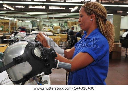 KIRYAT GAT, ISR - OCT 04:Worker at gas masks factory on Oct 04 2010.Only 58% percent of Israelis have gas masks.It estimated that it will coast $350 million USD to cover the rest of the population. - stock photo