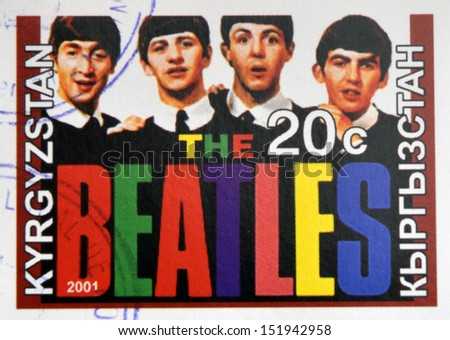 KIRZIGUISTAN - CIRCA 2001:  stamp printed in Kirziguistan shows the Beatles, circa 2001  - stock photo