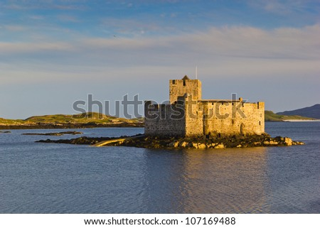 Kisimul Castle, also spelt Kiessimul Castle or Chisimul Castle, is a small medieval castle located in the centre of Castlebay on Barra, an island of the Outer Hebrides, Scotland. - stock photo