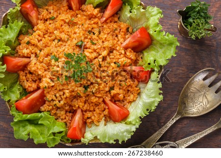 Kisir, traditional turkishr salad, Bulgur wheat   prepared with tomato paste, fresh tomatoes, parsley, olive oil.selective focus - stock photo