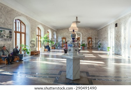 KISLOVODSK, RUSSIA - MAY 20 2015: Narzan gallery interior with narzan water source. Lot of people come to gallery to dring Narzan water - stock photo