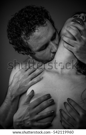Kiss, Couple of naked lovers embracing, kissing and caressing each other