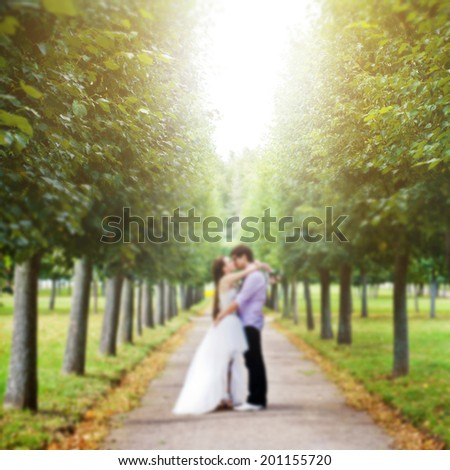 Kiss Suite at the mall. Blurred yellow background. - stock photo