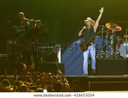 KISSIMMEE, FL-MAR 19: Singer Kenny Chesney performs onstage at the Runaway Country Music Fest at Osceola Heritage Park on March 19, 2016 in Kissimmee, Florida. - stock photo