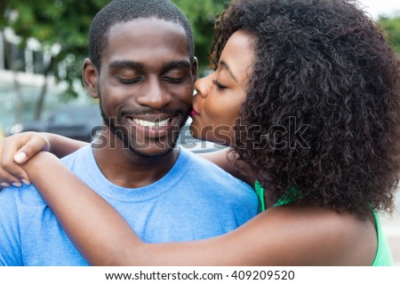Kissing african american couple - stock photo
