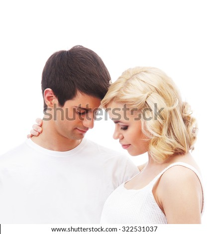 Kissing couple isolated on white
