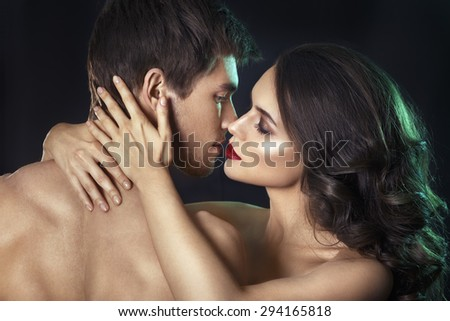 Kissing couple portrait.Sexy beauty couple.Portrait of happy loving couple.Pure passion.Sensual brunette woman in underwear with young lover, passionate couple foreplay closeup - stock photo