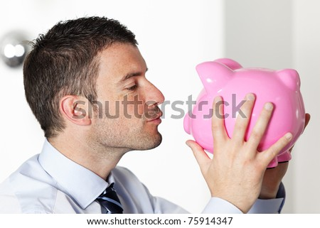 kissing piggy bank - stock photo
