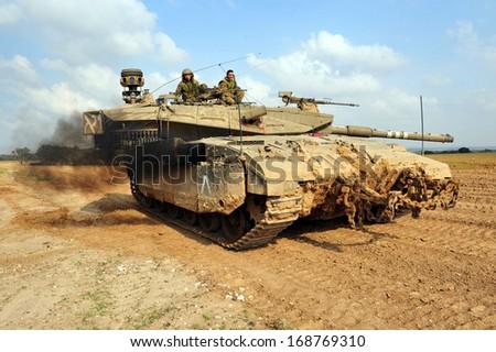 KISSUFIM,ISR - NOV 12:Merkava Tank on DEC 12 2008.The Mark IV has the Israeli-designed TSAWS system, It designed to endure the harsh basalt rock conditions of Golan Heights with minimal track-shedding - stock photo