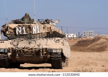 KISSUFIM, ISRAEL - DECEMBER 6: Merkava Tank on December 6 2007.The Mark IV has the Israeli-designed TSAWS system, It designed to endure the harsh basalt rock conditions of Golan Heights with minimal track-shedding - stock photo