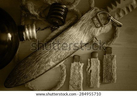kit for survival in the woods matches opener flask - stock photo
