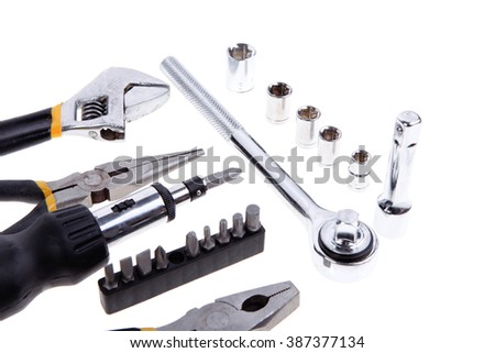kit of tools include pliers wrench ratche handle bushs and bit driver - stock photo