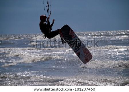 Kit Surfer in St. Peter-Ording  - stock photo