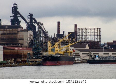 Kita-Kyushu, Fukuoka, Japan - July 9 2016. Ships docked at The Nippon Steel & Sumitomo Metal steel works factory at the Yawata Works district. The original iron works opened in this location in 1901.