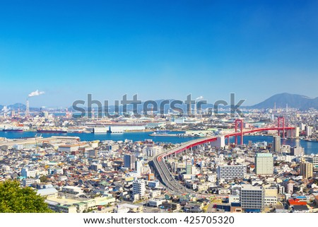 KITAKYUSHU, JAPAN - FEB 10: View of Kitakyushu City with Wakato Bridge on Feb 10, 2016 in Kitakyushu, Japan. With 960,000 inhabitants Kitakyushu is the second largest city in Kyushu.