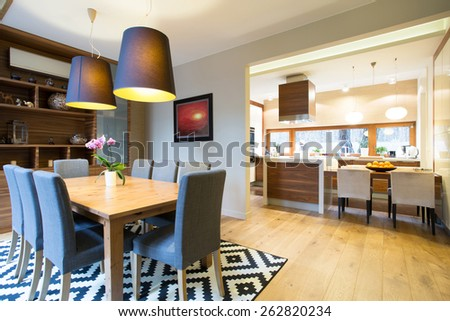 Kitchen and dining room in modern design interior - stock photo