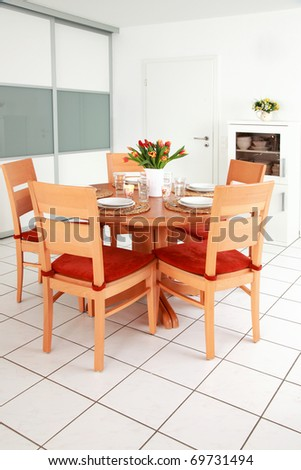 Kitchen and dining room interior in family house - stock photo