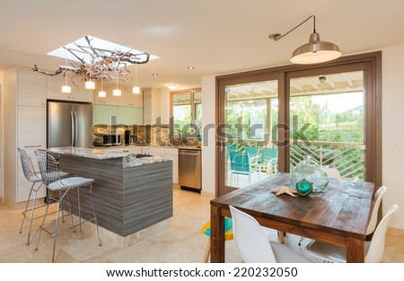 Kitchen and Dinning Room in Contemporary Modern Home - stock photo