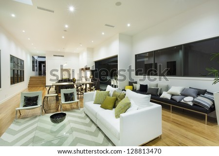 Kitchen and living area in luxury home - stock photo