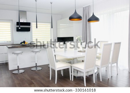 Kitchen and living room. White interior - stock photo