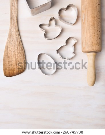 kitchen bake utensils with easter cookie cutters on white wooden background, top view,place for text - stock photo