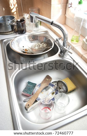 Kitchen conceptual image. Dirty sink with many dirty dishes. - stock photo