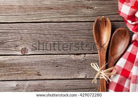 Kitchen cooking utensils over wooden table background. Top view with copy space - stock photo