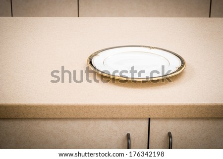 Kitchen Counter with Plate, Empty Dish - stock photo