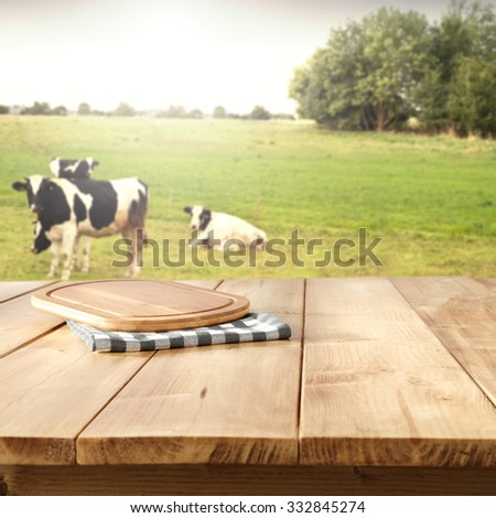 kitchen desk and cows and trees  - stock photo