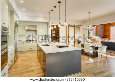 Kitchen, Dining Room, and Outdoor Patio in New Luxury Home. Slid - stock photo