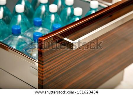 Kitchen drawer for water bottles - stock photo