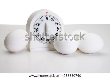 Kitchen egg timer and  tools for boiling eggs - stock photo