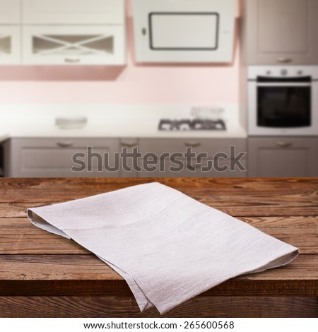 Kitchen. Empty wooden deck table with tablecloth for product montage. Free space for your text - stock photo