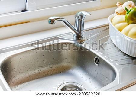 Kitchen faucet - stock photo