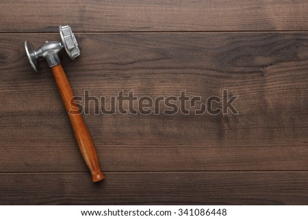 kitchen hammer on the brown wooden table