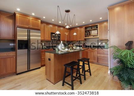 Kitchen in condominium with center island - stock photo