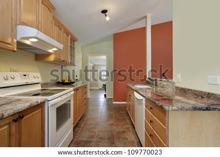 Kitchen in contemporary home with granite counters