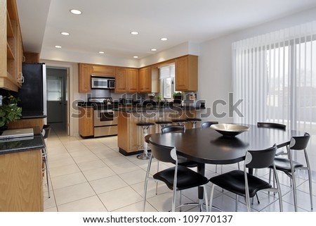 Kitchen in contemporary home with large eating area