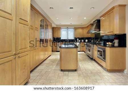 Kitchen in luxury home with black granite counters