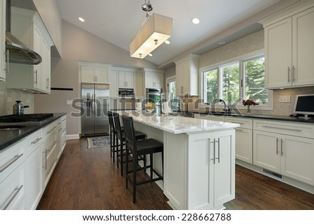 Kitchen in luxury home with granite counter island - stock photo