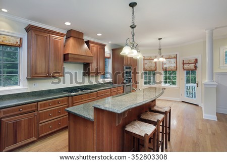 Kitchen in luxury home with granite top center island - stock photo