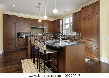 Kitchen in luxury home with oak wood cabinetry