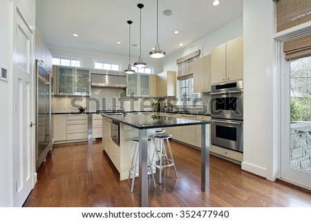 Kitchen in modern home with center island - stock photo