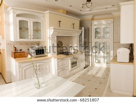 Kitchen in old style in light tones - stock photo